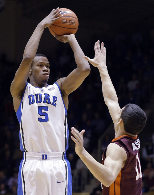 "FILE - In this Feb. 25, 2014 file photo, Duke's Rodney Hood (5) shoots over Virginia Tech's Devin Wilson during the first half of an NCAA college basketball game in Durham, N.C. Hood is entering the NBA draft. Hood said in a statement Friday, April 18, 2014, that playing for Mike Krzyzewski ""helped me grow and develop as a player and a person"" to prepare him for the NBA.  (AP Photo/Gerry Broome, File)"