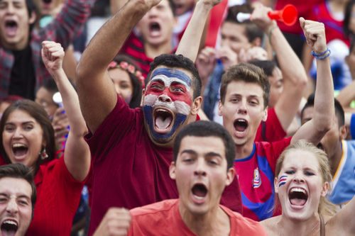 Costa Rica soccer fans celebrate their team's victory over Greece at a Brazil World Cup round of 16 game in San Jose, Costa Rica, Sunday, June 29, 2014. Costa Rica won a penalty shootout 5-3 after the match ended 1-1 following extra time. (AP Photo/Esteban Felix)