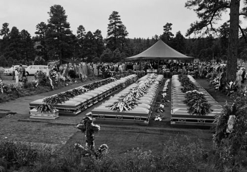 Nearly four hundred relatives and friends of the 70 people who died in the crash of a TWA Super-Constellation over the Grand Canyon June 30, attend a mass funeral service  in Flagstaff, Arizona, July 9, 1956. Sixty-seven caskets, three of the identified dead having been returned at relatives request to their homes, will be lowered into a common grave. (AP Photo/David F. Smith)
