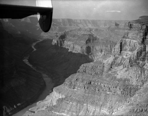 This is the view looking up the Colorado River with Chuar Butte at left, seen July 1, 1956.  The wreckage of the TWA Super-Constellation is at left, and the wreckage of the United Air Lines plane is at the far end of the butte.  (AP Photo/David F. Smith)