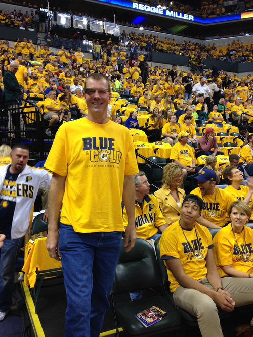 In this May 18, 2014 photo provided by Pacers.com, former indiana Pacers player Rik Smits smiles while wearing Google glasses during the Eastern Conference Finals at Bankers Life Fieldhouse in Indianapolis. The use of Glass in sports has progressed from trendy athletes dipping their toes in the water to a tool for teams looking to draw fans to arenas and stadiums, and then keep their focus on the action, instead of their omnipresent smartphones and tablets.  (AP Photo/Pacers.com, Celeste Ballou)