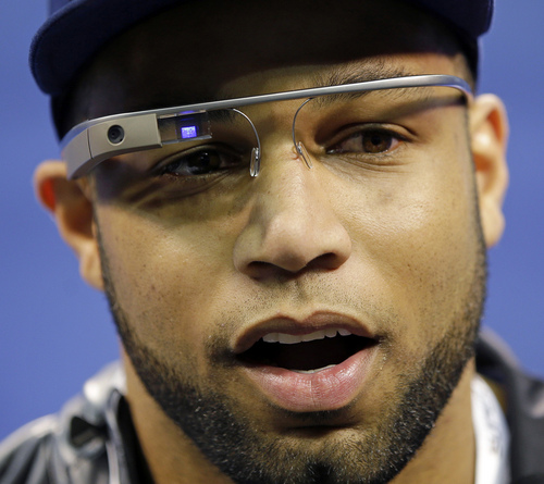 FILE - In this Jan. 28, 2014 file photo, Seattle Seahawks' Golden Tate wears Google glasses during media day for the NFL Super Bowl XLVIII football game, in Newark, N.J. The use of Glass in sports has progressed from trendy athletes dipping their toes in the water to a tool for teams looking to draw fans to arenas and stadiums, and then keep their focus on the action, instead of their omnipresent smartphones and tablets. (AP Photo/Matt Slocum, File)
