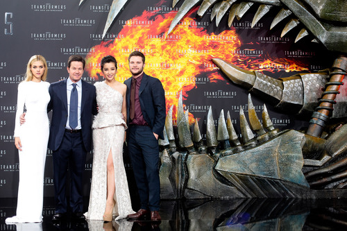 From left, actors Nicola Peltz, Mark Wahlberg, Li Bingbing, and Jack Reynor pose for photographers,  during the European premiere of the film 'Transformers: Age of Extinction',  at Potsdamer Platz in Berlin, Sunday, June 29, 2014. (AP Photo/Markus Schreiber)