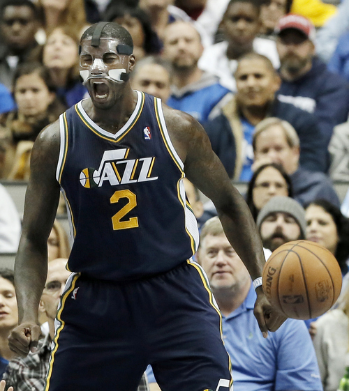 Utah Jazz forward Marvin Williams (2) reacts to a call against the Dallas Mavericks during the second half of an NBA basketball game on Friday, Nov. 22, 2013, in Dallas. Dallas won 103-93. (AP Photo/Brandon Wade)