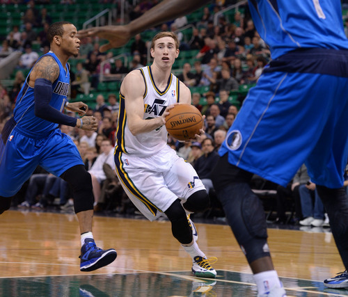Steve Griffin  |  The Salt Lake Tribune   Utah Jazz guard Gordon Hayward (20) drives into the lane during first half action in the Jazz versus Mavericks game at EnergySolutions Arena in Salt Lake City, Utah Wednesday, March 12, 2014.