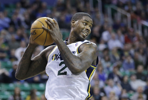Utah Jazz's Marvin Williams (2) pulls down a rebound in the second quarter during an NBA basketball game against the New Orleans Pelicans Wednesday, Nov. 13, 2013, in Salt Lake City.  (AP Photo/Rick Bowmer)
