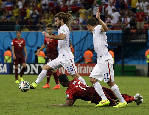 United States' Kyle Beckerman gets past Portugal's Nani during the group G World Cup soccer match between the USA and Portugal at the Arena da Amazonia in Manaus, Brazil, Sunday, June 22, 2014. (AP Photo/Martin Mejia)