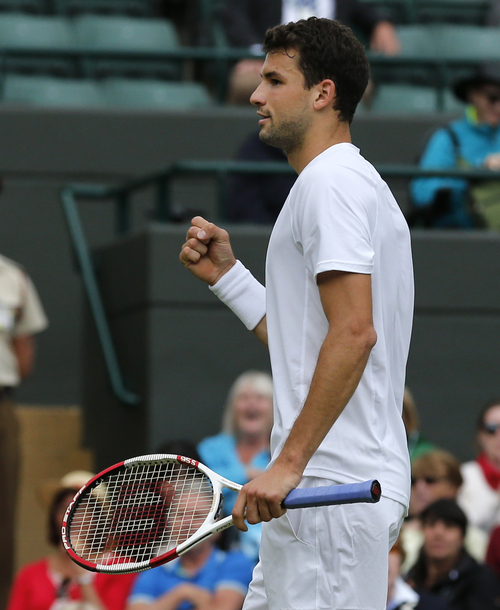 Grigor Dimitrov of Bulgaria celebrates winning a point against Leonardo Mayer of Argentina during their men's singles match at the All England Lawn Tennis Championships in Wimbledon, London, Monday, June 30, 2014. (AP Photo/Ben Curtis)