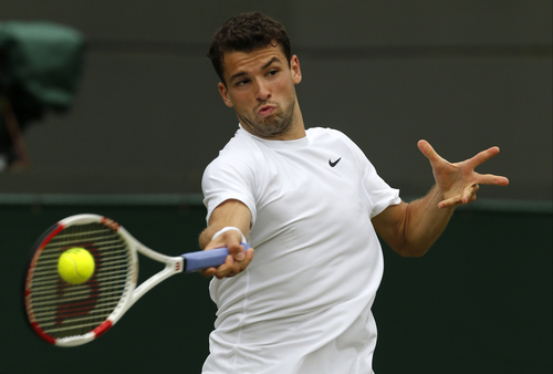 Grigor Dimitrov of Bulgaria plays a return to  Leonardo Mayer of Argentina during their men's singles match at the All England Lawn Tennis Championships in Wimbledon, London, Monday, June 30, 2014. (AP Photo/Ben Curtis)