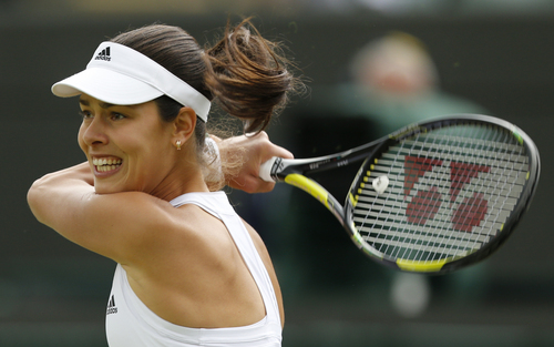 Ana Ivanovic of Serbia plays a return to Sabine Lisicki of Germany during their women's singles match at the All England Lawn Tennis Championships in Wimbledon, London, Monday, June 30, 2014. (AP Photo/Ben Curtis)
