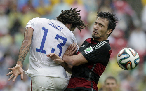 Germany's Mats Hummels, right, and United States' Jermaine Jones go for a header during the group G World Cup soccer match between the USA and Germany at the Arena Pernambuco in Recife, Brazil, Thursday, June 26, 2014. (AP Photo/Matthias Schrader)