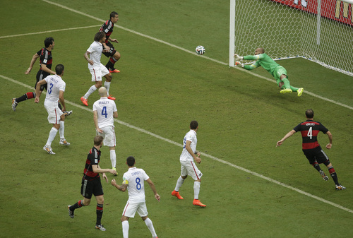 United States' goalkeeper Tim Howard blocks a shot by during the group G World Cup soccer match between the USA and Germany at the Arena Pernambuco in Recife, Brazil, Thursday, June 26, 2014. (AP Photo/Hassan Ammar)