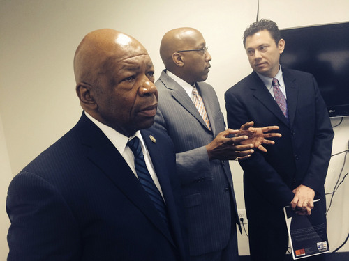 Thomas Burr  |  The Salt Lake Tribune Rep. Elijiah Cummings, D-Md., looks on as Center for Urban Families Executive Director Joseph Jones speaks with Rep. Jason Chaffetz, R-Utah, during a visit to the Baltimore facility that helps struggling families and works to help fathers take care of their kids. Cummings invited Chaffetz to visit Cummings' Baltimore district to learn what his constituents face. The two congressman are likely to be the top leaders on a powerful House committee next year.