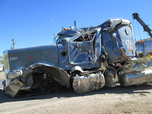 The driver and a passenger in this semi survived a crash with a pickup on U.S. 40 (UHP photo)