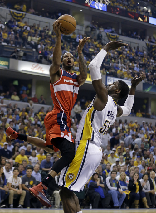 Washington Wizards forward Trevor Ariza, left, shoots over Indiana Pacers center Roy Hibbert during the first half of game 5 of the Eastern Conference semifinal NBA basketball playoff series Tuesday, May 13, 2014, in Indianapolis. (AP Photo/Darron Cummings)