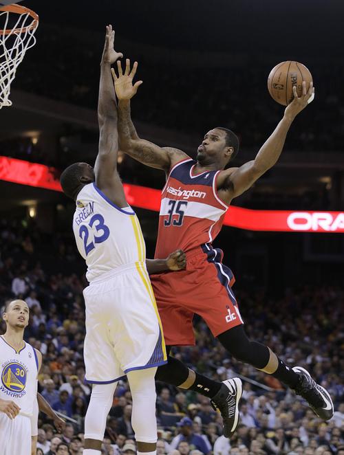 Washington Wizards' Trevor Booker, right, shoots over Golden State Warriors' Draymond Green (23) during the first half of an NBA basketball game, Tuesday, Jan. 28, 2014, in Oakland, Calif. (AP Photo/Ben Margot)