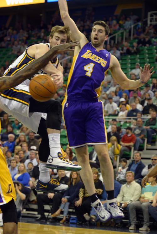 Rick Egan     The Salt Lake Tribune  Utah Jazz guard Gordon Hayward (20) tosses a pass, as Los Angeles Lakers forward Ryan Kelly (4) defends, in NBA action, The Utah Jazz vs. The Los Angeles Lakers, at EnergySolutions Arena, Monday, April 14, 2014