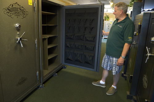 Leah Hogsten  |  The Salt Lake Tribune Paul Hicks, owner of Utah Safe Outlet in Bountiful, shows off the various sizes and makers of safes in his showroom Tuesday, July 1, 2014. The state of Utah is offering rebates to those who buy gun safes in  part of suicide prevention efforts.