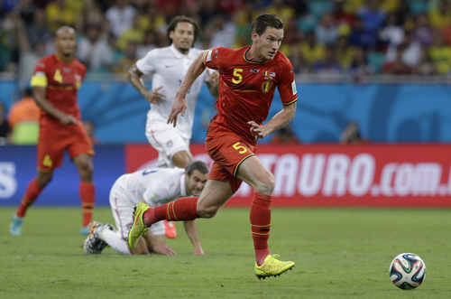 Belgium's Jan Vertonghen charges forward during the World Cup round of 16 soccer match between Belgium and the USA at the Arena Fonte Nova in Salvador, Brazil, Tuesday, July 1, 2014. (AP Photo/Matt Dunham)