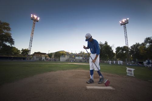 Rick Egan  |  The Salt Lake Tribune  Cyprus pitcher, Sebastian Bessert waters down the field, after a game between Tooele and Cyprus, at Utah Copper Park in Magna, Monday, June 30, 2014