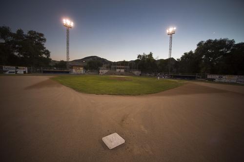 Rick Egan  |  The Salt Lake Tribune  Baseball fans watch a game between Tooele and Cyprus, at Utah Copper Park in Magna, Monday, June 30, 2014
