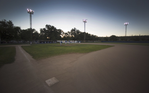 Rick Egan  |  The Salt Lake Tribune  Cyprus players work on the baseball diamond, at Utah Copper Park in Magna, Monday, June 30, 2014