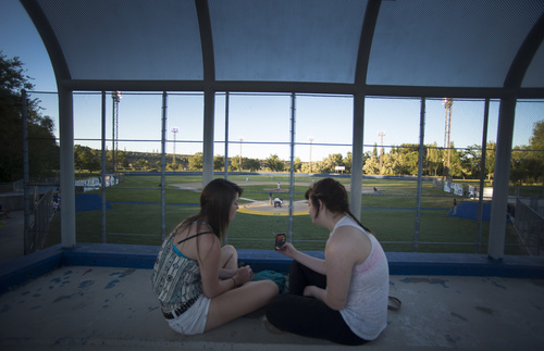 Rick Egan  |  The Salt Lake Tribune  Kristen Martin, and Krista Mitchell sit in what used to be the press box, on the top row during a game between Tooele and Cyprus, at Utah Copper Park in Magna, Monday, June 30, 2014