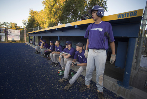 Rick Egan  |  The Salt Lake Tribune  Tooele players watch the game from the dugout, as they play Cyprus, at Utah Copper Park in Magna, Monday, June 30, 2014