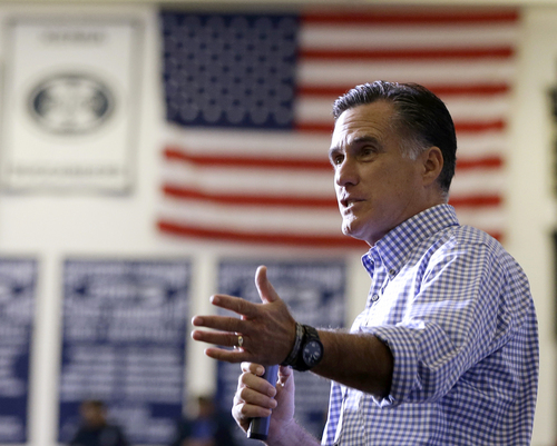 """FILE - This Oct. 30, 2012, file photo shows then-Republican presidential candidate, former Massachusetts Gov. Mitt Romney speaks in Kettering, Ohio. There may be more to that """"we the people"""" notion than you thought.These are boom times for the concept of """"corporate personhood."""" Corporations are people? Mitt Romney got mocked during the 2012 presidential campaign for the very idea. But it turns out the principle has been lurking in U.S. law for more than a century, and the Supreme Court, in a 5-4 ruling, gave it more oomph this week when it ruled that certain businesses are entitled to exercise religious rights just as do people. (AP Photo/Charles Dharapak, File)"""