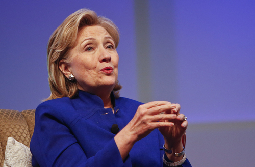 """FILE - This June 25, 2014, file photo shows former Secretary of State Hillary Rodham Clinton speaking in San Diego. There may be more to that """"we the people"""" notion than you thought.These are boom times for the concept of """"corporate personhood."""" Corporations are people? Mitt Romney got mocked during the 2012 presidential campaign for the very idea. But it turns out the principle has been lurking in U.S. law for more than a century, and the Supreme Court, in a 5-4 ruling, gave it more oomph this week when it ruled that certain businesses are entitled to exercise religious rights just as do people.  (AP Photo/Lenny Ignelzi, File)"""