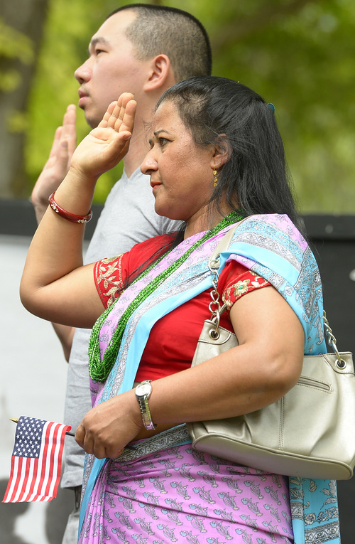 Leah Hogsten  |  The Salt Lake Tribune Hema Dulal, born in Bhutan, becomes a U. S. citizen. Fifteen new U.S. citizens from 13 countries became sworn citizens by U.S. Citizenship and Immigration Services as part of the America's Freedom Festival, Wednesday, July 3, 2014 in Orem's Scera Park.  Orem's ceremony is among 100 naturalization ceremonies immigration is having between June 30 and July 4.