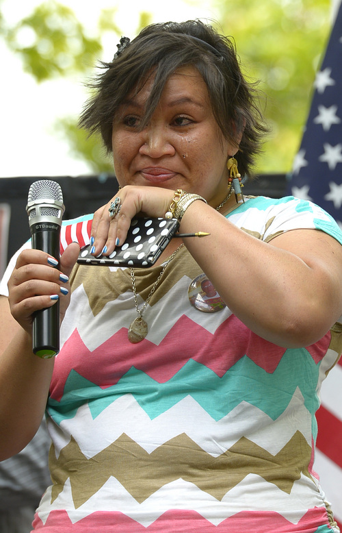 Leah Hogsten  |  The Salt Lake Tribune Octavia Schubert of Western Samoa thanks her family for their support during a brief speech after she became a U. S. citizen. Fifteen new U.S. citizens from 13 countries became sworn citizens by U.S. Citizenship and Immigration Services as part of the America's Freedom Festival, Wednesday, July 3, 2014 in Orem's Scera Park.  Orem's ceremony is among 100 naturalization ceremonies immigration is having between June 30 and July 4.