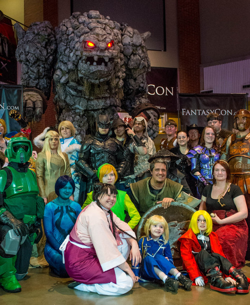 Trent Nelson  |  The Salt Lake Tribune Cosplayers pose with Rocky, a 15-foot animatronic rock monster, at an event to promote the upcoming FantasyCon, at The District Theatre in South Jordan, Wednesday April 9, 2014.