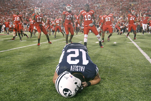 Chris Detrick  |  The Salt Lake Tribune Brigham Young Cougars wide receiver JD Falslev (12) collapses on the field after a potential game-tying field goal is missed at Rice-Eccles Stadium on Saturday, Sept. 15, 2012.  Utah won the game 24-21.