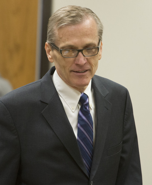 Rick Egan  |  The Salt Lake Tribune  Martin MacNeill enters the courtroom for his trial on forcible sexual abuse, Wednesday, July 2, 2014.