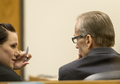Rick Egan  |  The Salt Lake Tribune  Defense attorney, Kara North, talks to  Martin MacNeill  during a break in his trial on forcible sexual abuse, in 4th District Judge Samuel McVey's courtroom, in Provo, Wednesday, July 2, 2014