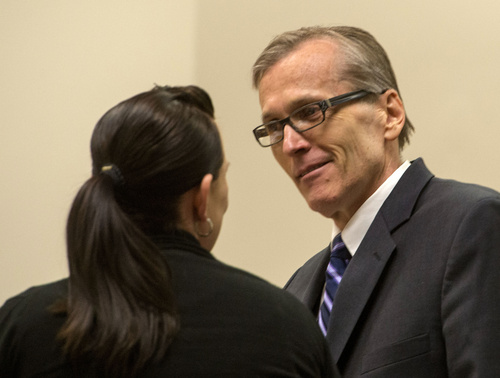 Rick Egan  |  The Salt Lake Tribune  Defense attorney, Kara North, talks to  Martin MacNeill, during a break in his trial on forcible sexual abuse, in 4th District Judge Samuel McVey's courtroom, in Provo, Wednesday, July 2, 2014