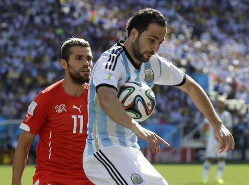 Argentina's Gonzalo Higuain controls the ball during the World Cup round of 16 soccer match between Argentina and Switzerland at the Itaquerao Stadium in Sao Paulo, Brazil, Tuesday, July 1, 2014. (AP Photo/Sergei Grits)