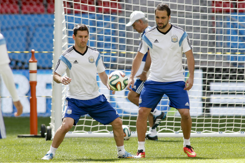 Argentina's Lionel Messi, left, and Argentina's Gonzalo Higuain take part in a training session at Estadio Nacional in Brasilia, Brazil, Friday, July 4, 2014. On Saturday, Argentina will face Belgium in their World Cup quarterfinals soccer match. (AP Photo/Eraldo Peres)