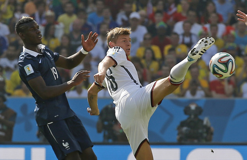 Germany's Toni Kroos, right, is challenged by France's Paul Pogba during the World Cup quarterfinal soccer match between Germany and France at the Maracana Stadium in Rio de Janeiro, Brazil, Friday, July 4, 2014. (AP Photo/David Vincent)