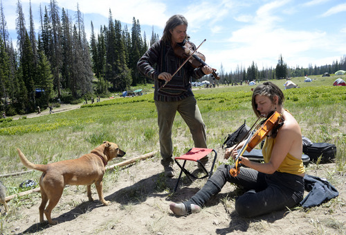 "Al Hartmann  |  The Salt Lake Tribune  Music is everywhere at the Rainbow Family Gathering in the Uinta Mountains 15 miles northeast of Heber.  ""John"" from Denver and ""Shannon"" of San Antonio jam together on violins at a campsite."