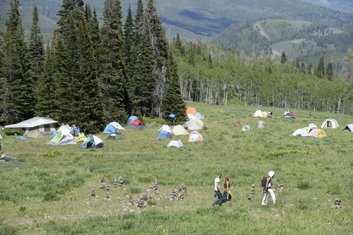 Al Hartmann  |  The Salt Lake Tribune  Camping tents are widely dispersed over a large area for the  Rainbow Family Gathering in the Uinta Mountains 15 miles northeast of Heber.  There is a large circle in the camp center where communal meals are served and for special events.