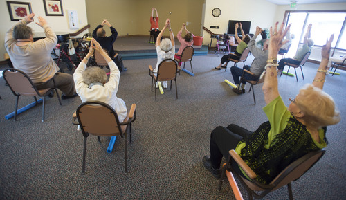 Steve Griffin  |  The Salt Lake Tribune   Debra Leneave leads a stretch class with residents at  Highland Cove in Salt Lake City, Utah Thursday, July 3, 2014. The population of seniors in Utah (and nation) is soaring even as nursing home residency declines. Among reasons for the seemingly contradictory trend is the increasing number of alternatives for seniors -- including independent living and assisted living centers.  I