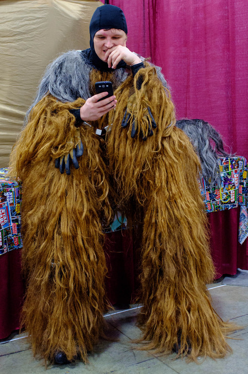 Trent Nelson  |  The Salt Lake Tribune Dartanian Richards, dressed as Chewbacca, takes a break to check his messages at FantasyCon, held at the Salt Palace Convention Center in Salt Lake City on Saturday.