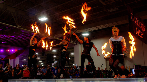 Trent Nelson  |  The Salt Lake Tribune Voodoo Productions perform with fire at FantasyCon, held at the Salt Palace Convention Center in Salt Lake City, Saturday July 5, 2014. Left to right are Heidi Butterfly, Pretty Macabre, Chad Ashment and Holly Hoopster.