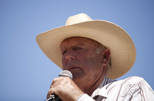 FILE - In this April 24, 2014, file photo, rancher Cliven Bundy speaks at a news conference near Bunkerville, Nev. U.S. Bureau of Land Management officials say they agree with a Nevada sheriff's position that rancher Bundy must be held accountable for his role in an April standoff between his supporters and the federal agency. Clark County Sheriff Doug Gillespie said Bundy crossed the line when he allowed states' rights supporters, including self-proclaimed militia members, onto his property to aim guns at police. (AP Photo/Las Vegas Review-Journal, John Locher, File)