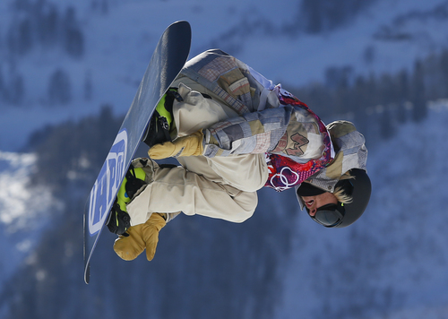 United States' Sage Kotsenburg takes a jump during the men's snowboard slopestyle qualifying at the Rosa Khutor Extreme Park ahead of the 2014 Winter Olympics, Thursday, Feb. 6, 2014, in Krasnaya Polyana, Russia.  (AP Photo/Sergei Grits)