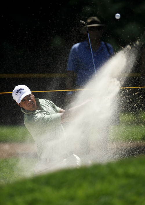 Francisco Kjolseth  |  The Salt Lake Tribune Tony Finau of Lehi, UT, digs out of the sand in hole 2 in the Nationwide Tour, the Triple-A of the PGA Tour, as it makes its stop at the Willow Creek Country Club in Sandy on Thursday, July 28, 2011, for the first of four days.