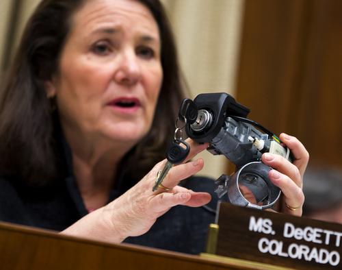 """FILE - In this April 1, 2014 file photo, Rep. Diana DeGette, D-Colo., ranking member of the House Oversight and Investigations subcommittee, holds up a GM ignition switch while she questions General Motors CEO Mary Barra on Capitol Hill in Washington. Responding to complaints about """"cheap-feeling"""" switches that required too much effort to turn, General Motors set about making new ones that would work more smoothly and give drivers the impression that they were better designed, a GM switch engineer testified in a lawsuit deposition in the spring of 2013. The switches, though, were too loose, touching off events that led to at least 13 deaths, more than 50 crashes and a raft of legal trouble for the Detroit automaker. (AP Photo/Evan Vucci, File)"""
