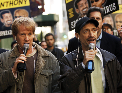 """FILE - In a April 26, 2006 file photo, radio shock jocks Greg """"Opie"""" Hughes, left, and Anthony Cumia, right, leave CBS Radio studios on 57th Street with fans after finishing their first morning show, in New York.  Cumia of the """"Opie & Anthony"""" radio show was fired late Thursday, July 3, 2014 by SiriusXM, who cited his """"racially charged"""" and """"hate-filled"""" remarks on Twitter as the reason. (AP Photo/ Louis Lanzano, File)"""